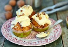 Carrot cupcakes. On rustic background Stock Photo