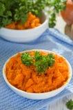 Carrot dip. In white gravy boat Royalty Free Stock Image