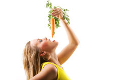 Carrot eating sideways Royalty Free Stock Photography