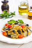 Carrot fettuccine with aubergine and olive Royalty Free Stock Images