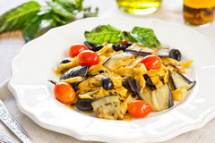 Carrot fettuccine with aubergine and olive Stock Photos