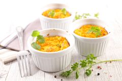 Carrot flan or souffle. And herbs Royalty Free Stock Photography