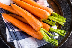 Carrot. Fresh Carrots bunch. Baby carrots. Raw fresh organic orange carrots. Healthy vegan vegetable food.  royalty free stock images
