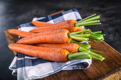 Carrot. Fresh Carrots bunch. Baby carrots. Raw fresh organic orange carrots. Healthy vegan vegetable food Stock Image