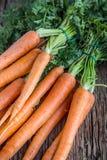 Carrot. Fresh Carrots bunch. Baby carrots. Raw fresh organic orange carrots. Healthy vegan vegetable food Royalty Free Stock Photography
