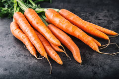Carrot. Fresh Carrots bunch. Baby carrots. Raw fresh organic orange carrots. Healthy vegan vegetable food.  Fresh Vegetable Stock Image