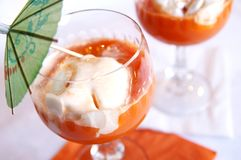 Carrot fresh cocktail with ice-cream stock image