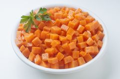 Carrot. Fresh and colorful dish full of diced carrot ready to cook Stock Images