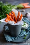 Carrot fries with sour cream and garlic dip stock photos