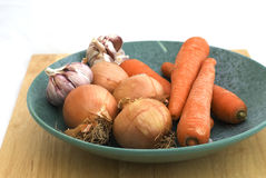 The carrot,garlic and onion on plate Stock Photo