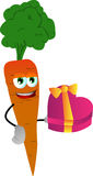 Carrot with gift for Valentines Day Stock Image