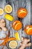 Carrot ginger immune boosting, anti inflammatory lemonade with turmeric and honey. Detox drink. Carrot ginger immune boosting, anti inflammatory lemonade with Royalty Free Stock Image