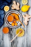 Carrot ginger immune boosting, anti inflammatory smoothie with turmeric and honey. Detox drink Stock Photos