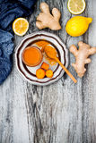 Carrot ginger immune boosting, anti inflammatory smoothie with turmeric and honey. Detox drink. Carrot ginger immune boosting, anti inflammatory smoothie with Stock Photo