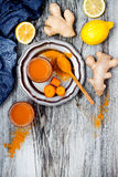Carrot ginger immune boosting, anti inflammatory smoothie with turmeric and honey. Detox drink Royalty Free Stock Photo