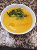 Carrot ginger soup. With buckwheat, cinnamon, orange juice and coconut milk Royalty Free Stock Photo