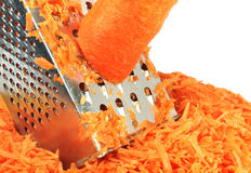 Carrot and grater for vegetables Stock Photography