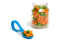 Carrot and green peas Stock Image