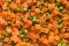 Carrot and green peas Royalty Free Stock Photography