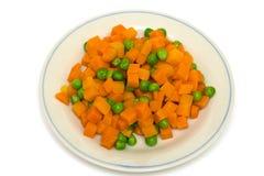 Carrot and green peas Stock Photos