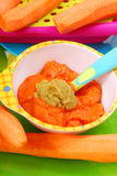 Carrot and green peas  puree for baby Royalty Free Stock Photo