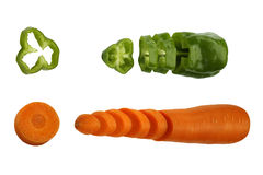 Carrot and green pepper. Cut carrot and green pepper isolated on a white background Royalty Free Stock Photo