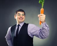 Carrot in hand Royalty Free Stock Photo