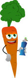 Carrot holding toothpaste Royalty Free Stock Image