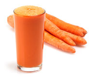 Carrot juice. And carrot on white background Royalty Free Stock Images