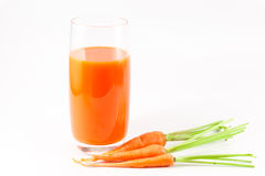 Carrot  juice. Carrots and carrot juice isolated on white background Royalty Free Stock Photos