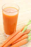 Carrot juice. Glass of fresh carrot juice and some fresh vegetables stock photo