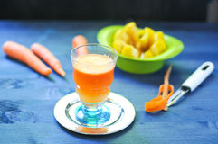 Carrot juice with apple and ginger. Lemon Royalty Free Stock Photography