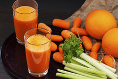 Carrot juice with celery and orange Royalty Free Stock Photo