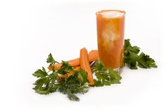 Carrot juice and fresh greens Stock Photography