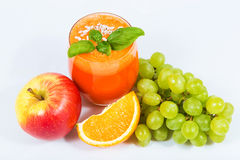 Carrot juice with fruit juicers Royalty Free Stock Photography