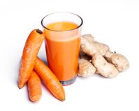 Carrot juice with ginger root. On a white background Royalty Free Stock Photos
