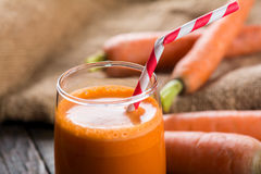 Carrot juice. A glass of freshly squeezed carrot juice Royalty Free Stock Images