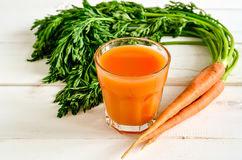 Carrot juice. Glass of freshly squeezed ripe carrot juice. Selective focus Stock Photography