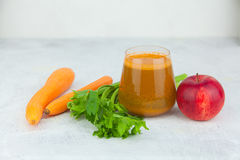 Carrot juice in glass on  table Royalty Free Stock Photos