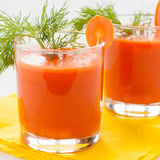 Carrot juice in glasses, closeup. Carrot juice in glasses decorated with dill and a slice of carrot, closeup Royalty Free Stock Photos