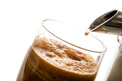 Carrot juice with a juicer Royalty Free Stock Image