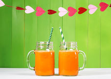 Carrot juice in masons jars Stock Images