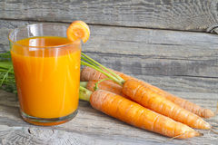 Carrot juice organic on wooden boards Royalty Free Stock Images