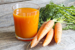 Carrot juice organic on wooden boards Royalty Free Stock Photography