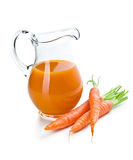 Carrot juice in pitcher with carrots Stock Photography