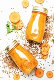 Carrot juice or smoothies with flax seeds in glass bottles, vegan beverage, healthy drink for clean raw diet, selective focus stock image