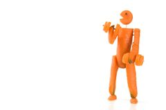 Carrot man fitness. Puppet made of carrot doing the weight lifting stock image