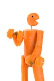 Carrot man fitness. Puppet made of carrot doing the weight lifting royalty free stock photos