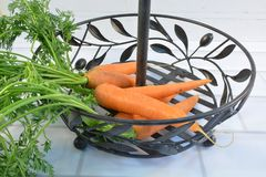 Carrot in a metal basket waiting for cooking royalty free stock photography