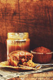 Carrot muffins and caramel sauce on wooden background Royalty Free Stock Image